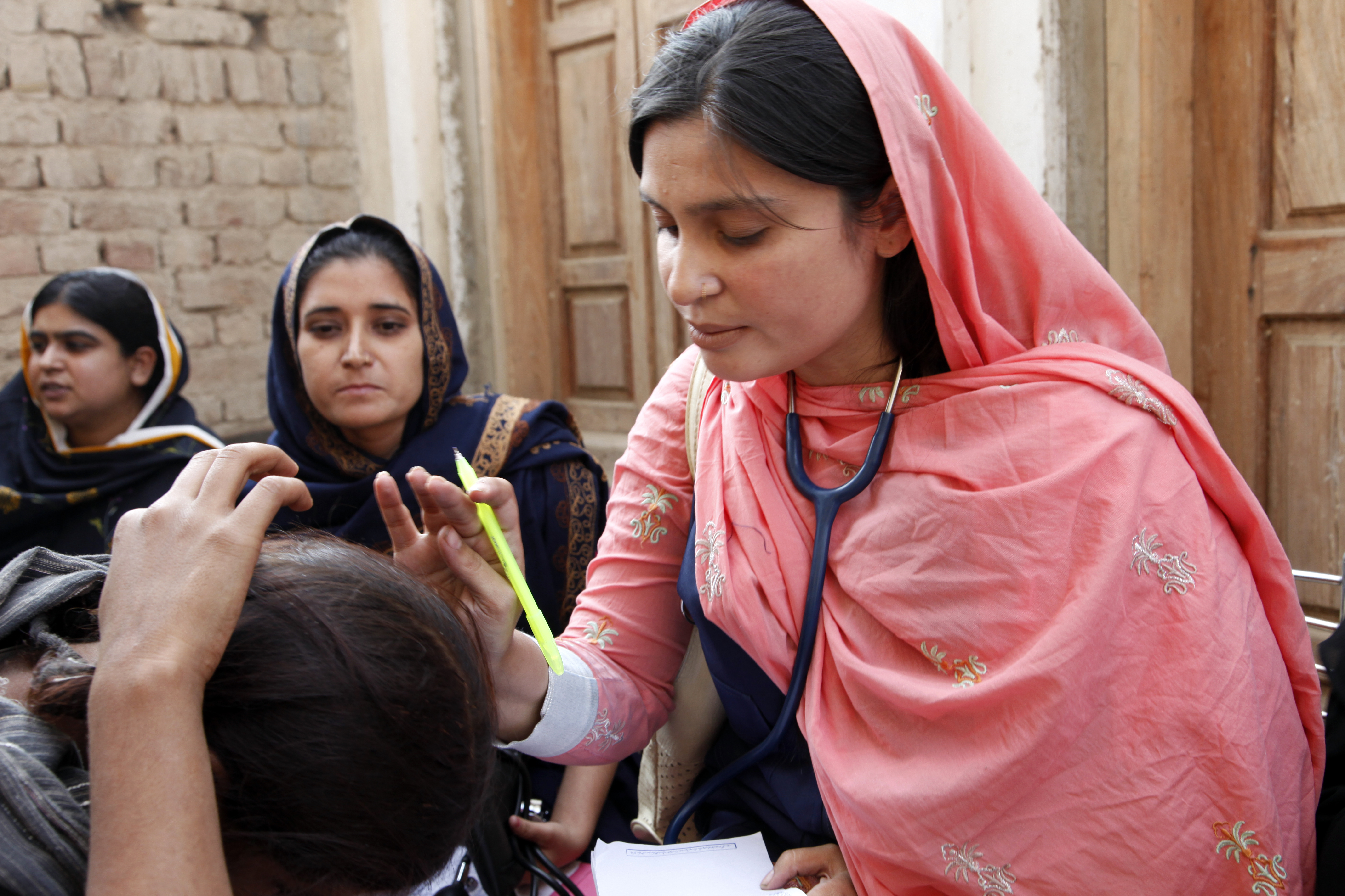A female doctor with the International Medical Corps examines a
