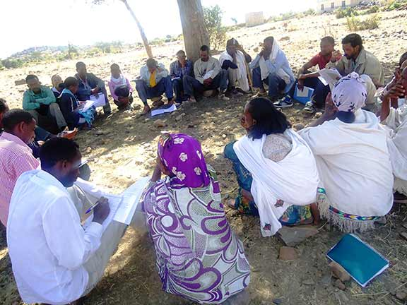 Men and women gather for a participatory community quality improvement meeting in Ethiopia maternal health respectful maternity care