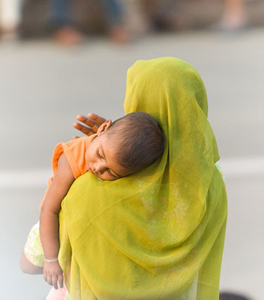 A mother holds her child near the Indian-Pakistan border