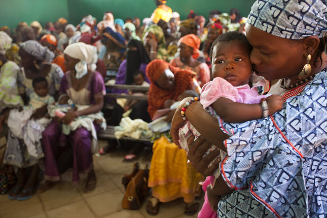 Mothers wait to vaccinate their babies in Bamako, Mali,