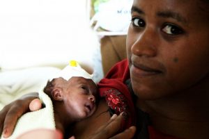 Woman with one month old newborn daughter