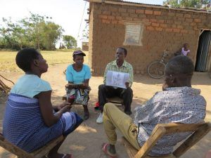 MCSP-trained community health workers Obeid Joseph and Deborah Denis discuss reproductive and maternal health issues with a couple during a home visit