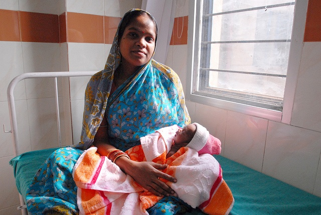 """DSC_3569 A mother and her newborn child, beneficiaries of a UK-funded maternal health and family planning programme in Orissa, one India's poorest states"" © 2011 DFID, used under a Creative Commons Attribution license https://creativecommons.org/licenses/by-sa/2.0/"